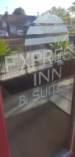 glass door to Express Inn & Suites