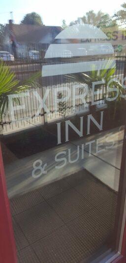 glass door to Express Inn & Suites