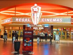 Regal Cinemas movie theatre with people in lobby area