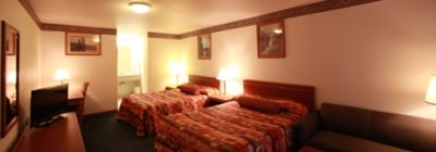 Bedroom with 2 queen beds at Express Inn and Suites, Eugene, OR